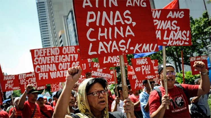 Anti China protesters at a rally in Manila against China's territorial claims. Dondi Tawatao